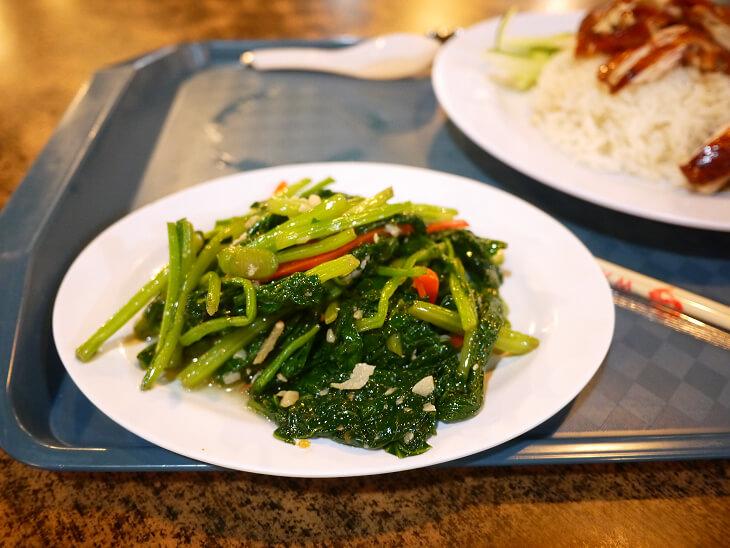 フードジャンクション 厨房 食霸海鮮魚头炉の青菜の炒め物画像